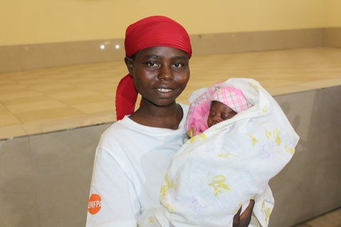 Virginie Nduwimana with her new born sharing her joy to be able to arise her baby
